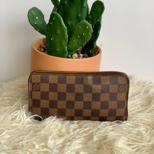 Louis Vuitton Zippy wallet in Damien Ebene
